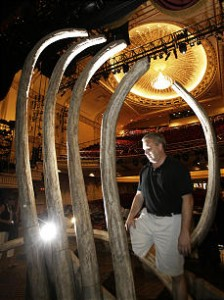 Head carpenter Michael Carey works on setting up for the Lion King at the Capitol Theatre in Salt Lake City