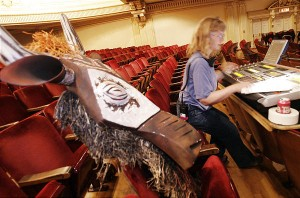 Meg Sump works on audio during set up for the Lion King at the Capitol Theatre in Salt Lake City