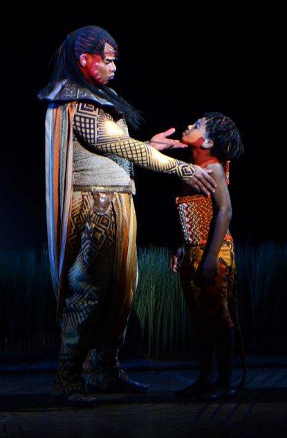 Mufasa played by Dionne Randolph and Simba played by Jelani Remy