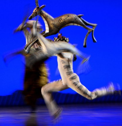 An antelope flies across the stage