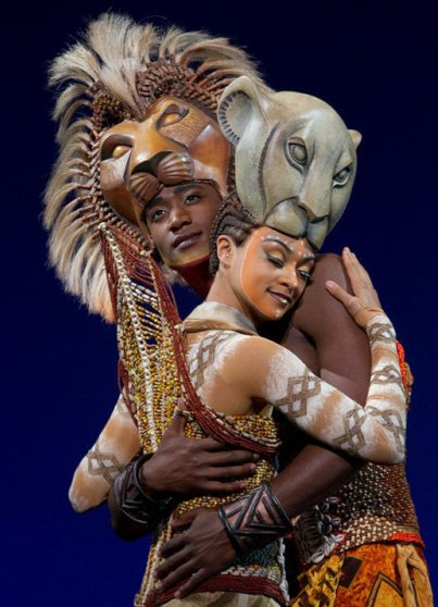 Syndee Winters as Nala embraces Jelani Remy as Simba in The Lion King